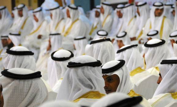 Grooms take part in a mass wedding ceremony in Tabuk