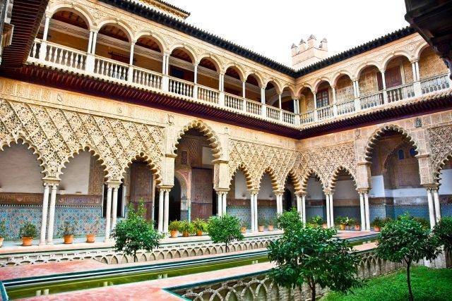 Courtyard with water pool of Casa de Pilatos, Seville, Andalusia, Spain