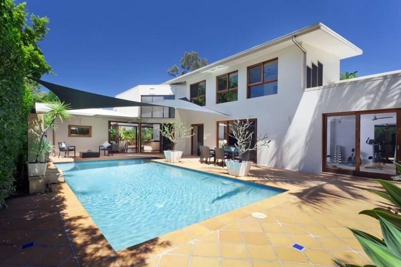 Modern backyard with swimming pool in Australian mansion