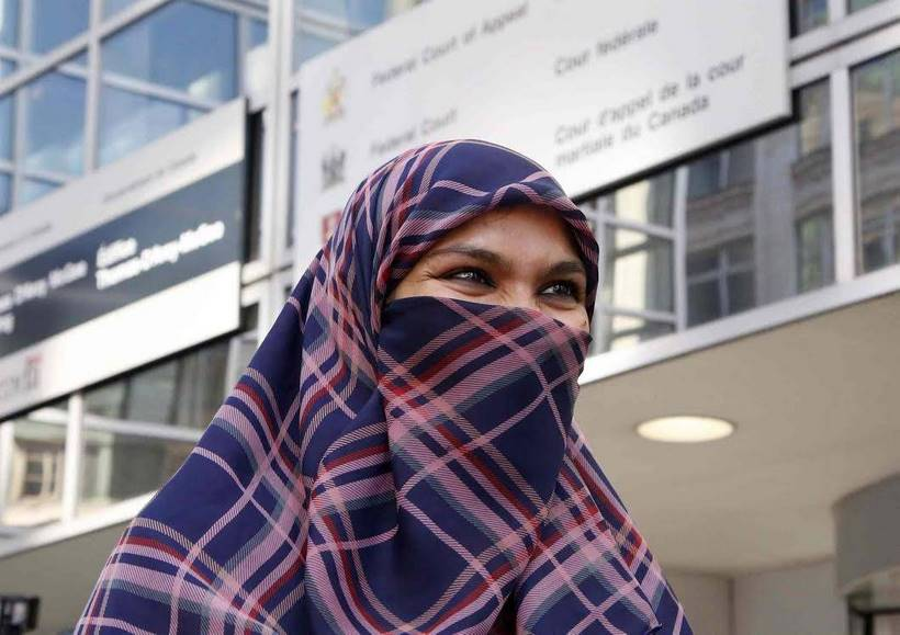 Zunera Ishaq talks to reporters outside the Federal Court of Appeal after her case was heard on whether she can wear a niqab while taking her citizenship oath, in Ottawa on Tuesday, September 15, 2015. THE CANADIAN PRESS/ Patrick Doyle