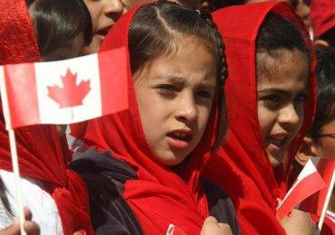 CALGARY, ALBERTA: JULY 1, 2009-Children from the Ahmadiyya Muslim community sing O' Canada during the opening ceremonies of the Canada Day festivities hosted by the mosque and community Wednesday July 1st at Prairie Winds Park in Castleridge. (Ted Rhodes/Calgary Herald) (For City story by Jamie Kormanicki)
