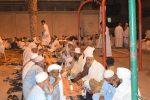 Des Mecquois organisent un dîner en l'honneur des pèlerins vivant avec eux dans le quartier